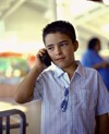 Latino boy on mobile phone