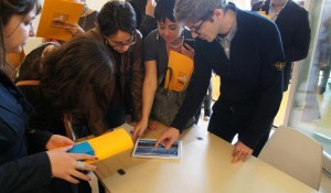 Experientia designer Renzo Giusti shows journalists how the interface works.