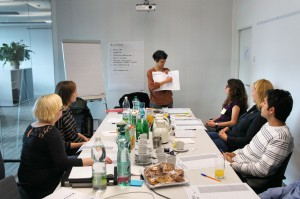 Vienna, Austria. The moderator describes how to execute an exercise during a participatory workshop.
