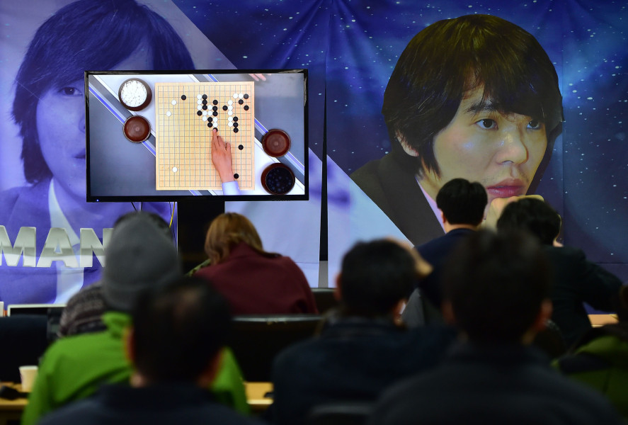 South Korean Go game fans watch a television screen broadcasting live footage of the Google DeepMind Challenge Match, at the Korea Baduk Association in Seoul on March 9, 2016.  A 3,000-year-old Chinese board game was the focus of a very 21st century showdown as South Korean Go grandmaster Lee Se-Dol kicked off his highly anticipated clash with the Google-developed supercomputer, AlphaGo. / AFP / JUNG YEON-JE        (Photo credit should read JUNG YEON-JE/AFP/Getty Images)